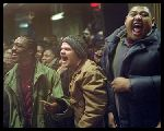 "DJ Iz (De'Angelo Wilson), Chedder Bob (Evan Jones) and Sol (Omar Benson Miller) go crazy as Jimmy's freestyle rap decimates the competition at The Shelter club in ""8 Mile"""