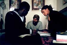 Derek Luke, director Denzel Washington and Joy Bryant on the set of Fox Searchlight's Antwone Fisher - 2002
