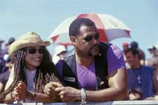 Queenie (LISA BONET) and Smoke (LAURENCE FISHBURNE) watch a race from the sidelines.