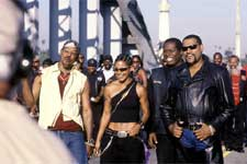 Members of the Black Knights, including (left to right) Soul Train (ORLANDO JONES), Half & Half (SALLI RICHARDSON-WHITFIELD), Rev. Maxwell (WREN T. BROWN) and their leader Smoke (LAURENCE FISHBURNE) revel in another victory.