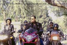 Smoke (LAURENCE FISHBURNE, center) leads a processional of motorcycle racers, flanked by two members of his Black Knights, Half & Half (SALLI RICHARDSON, left) and SOUL TRAIN (ORLANDO JONES, right), to honor a fallen member of their club.n
