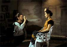 Director Julie Taymor and Salma Hayek behind the scenes of FRIDA.