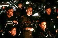 Clockwise from lower left: Hilary Swank, Aaron Eckhart, Delroy Lindo, Stanley Tucci, Tcheky Karyo and Bruce Greenwood in Paramount's The Core - 2003